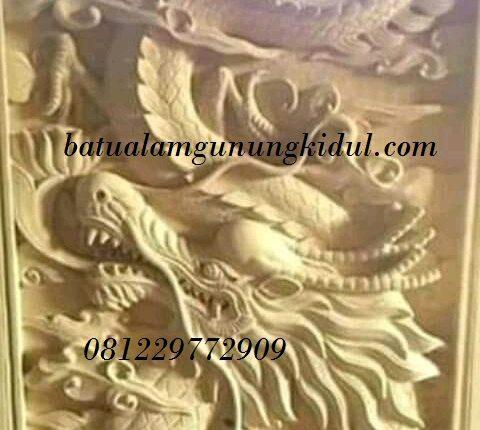 relief motif naga batu alam
